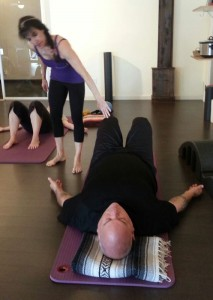 Lee Vallely helping me with a new exercise during Saturday's class at RedBird Pilates